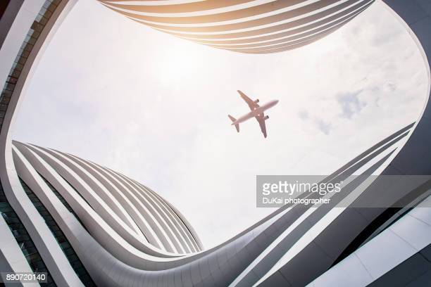 modern architecture in beijing - aeroplane stock pictures, royalty-free photos & images