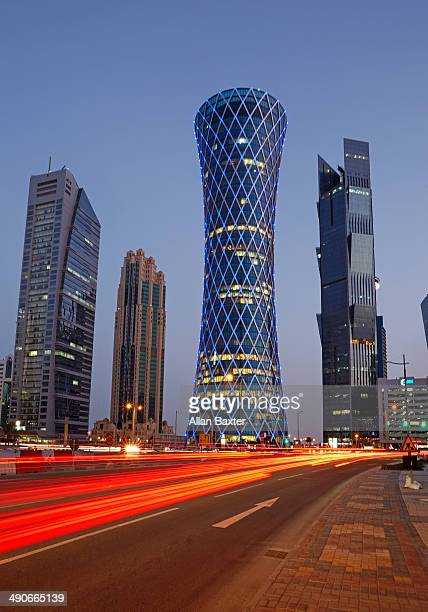 modern architecture in doha at dusk - tower stock pictures, royalty-free photos & images