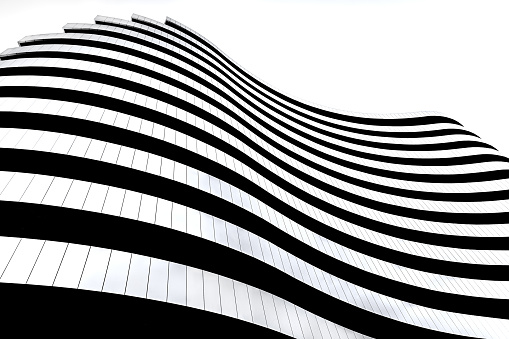 Modern architecture in Serbia. Waves facade design. Building in the shape of a flag. 1138171268