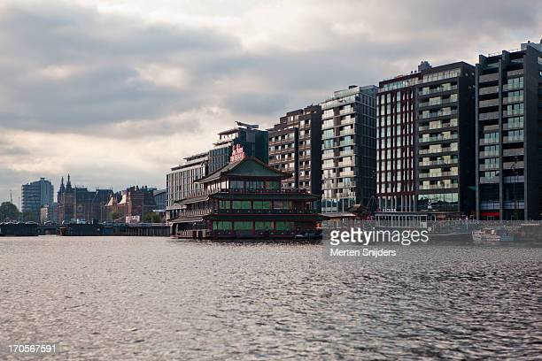 modern architecture on oosterdokeiland - merten snijders stock pictures, royalty-free photos & images