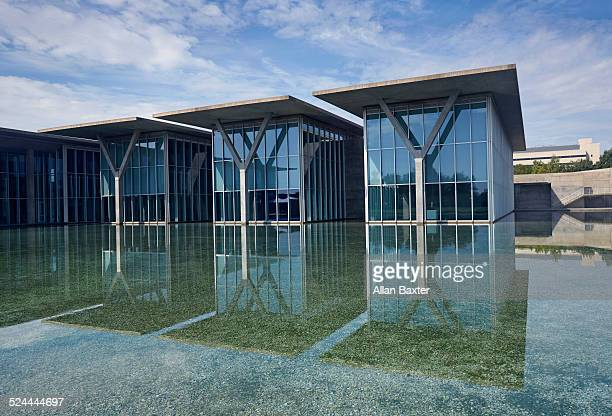 Modern art museum of Fort Worth reflected in pool
