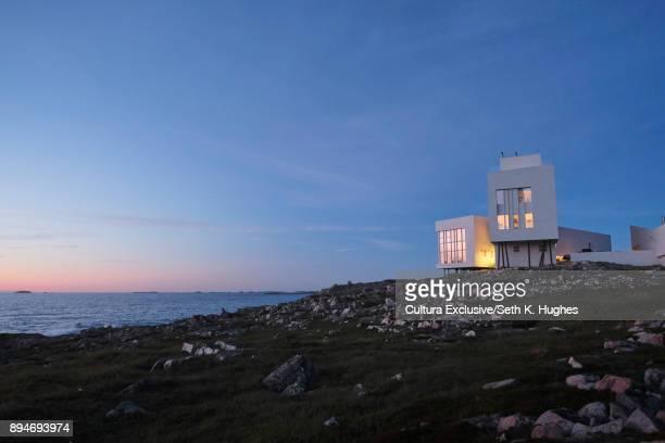 Modern artists studio on edge of coast at dusk, Fogo Island, Canada