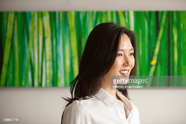Modern Asian business woman smiling, profile