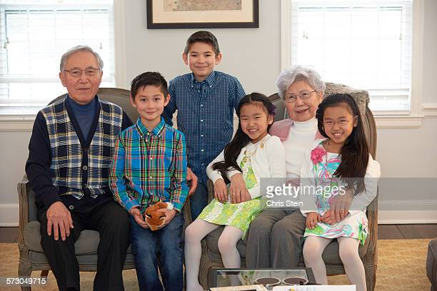 modern asian family - scarsdale stock photos and pictures