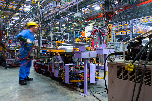 Modern automatic automobile manufacturing workshop. A busy car production line. Industrial scenery background. 1168959548
