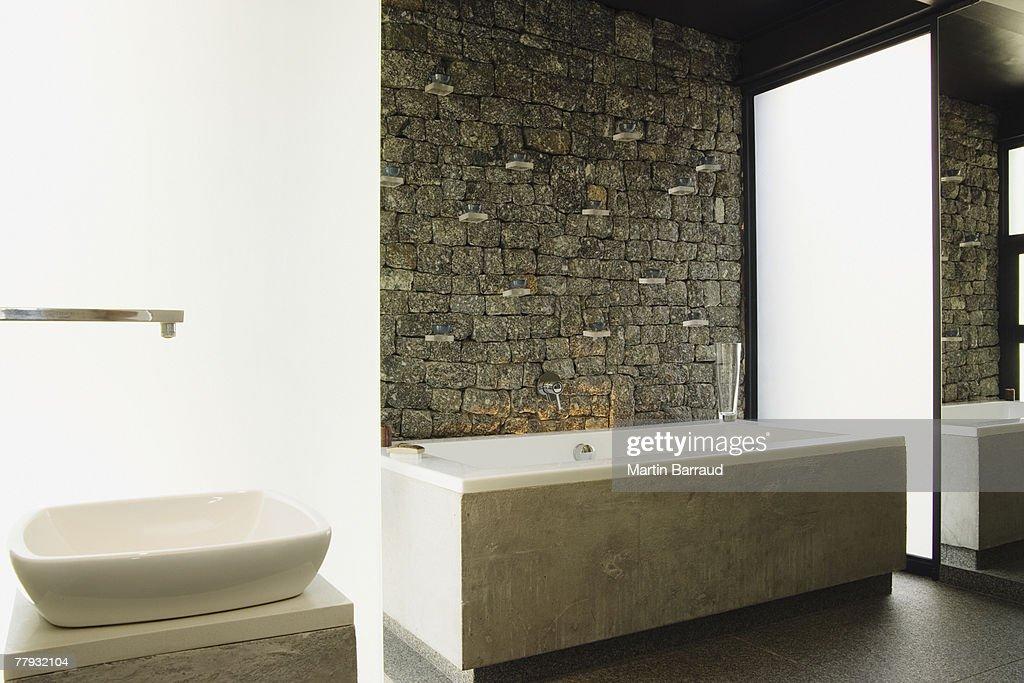 Modern bathroom bathtub and sink : Stock Photo