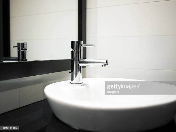 Modern bathroom sink with mirror reflection