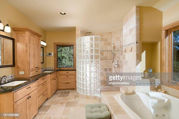 Modern bathroom with large, open shower,  jet tub