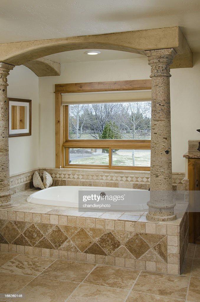 Modern Bathroom With Pillars And Sunken Bathtub : Stock Photo