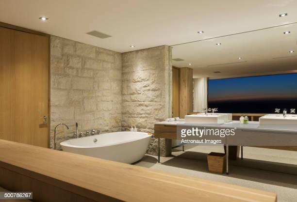 Modern bathroom with soaking tub at night
