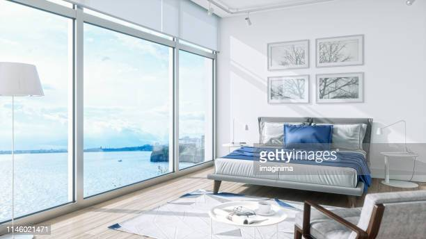 modern bedroom interior with sea view - scenics stock pictures, royalty-free photos & images