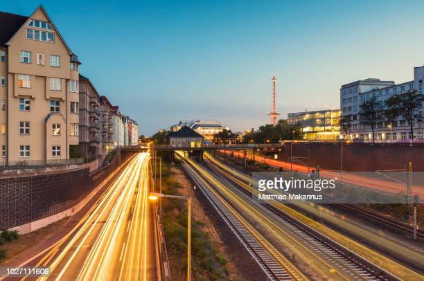 modern berlin city funkturm skyline in summer with icc and traffic - makarinus stock photos and pictures