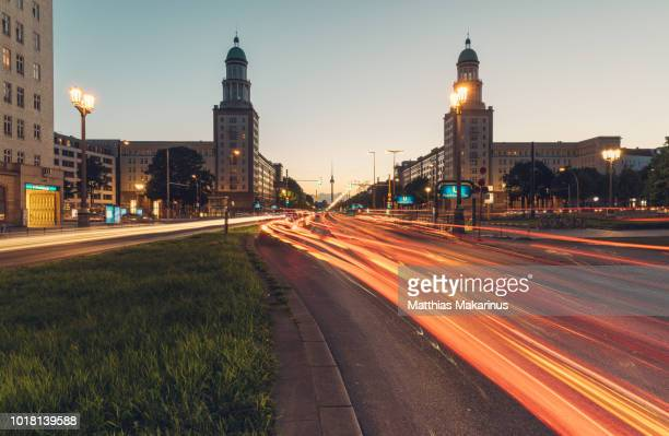 modern berlin city skyline in summer with frankfurter tor and traffic - friedrichshain stock photos and pictures