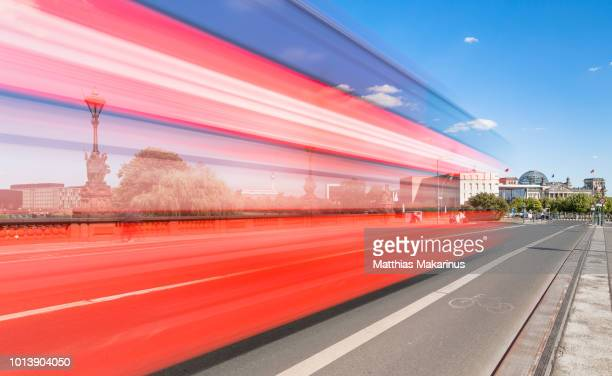 modern berlin city skyline in summer with reichstag and traffic - makarinus stock photos and pictures