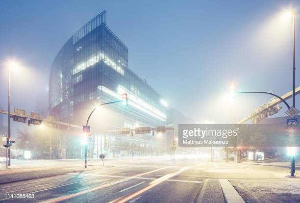 modern berlin potsdamer platz city night skyline with traffic and foggy - road signal stock pictures, royalty-free photos & images