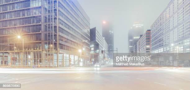 Modern Berlin Potsdamer Platz City Night Skyline with Traffic and Foggy