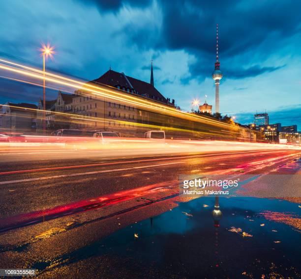modern berlin urban night skyline with traffic and city reflection - テレビ塔 ストックフォトと画像