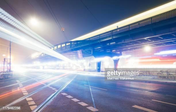 modern berlin urban rush hour city street night skyline with traffic and foggy - プレンツラウアーベルグ ストックフォトと画像