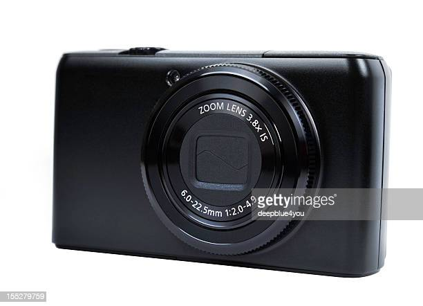 Modern black compact camera on white