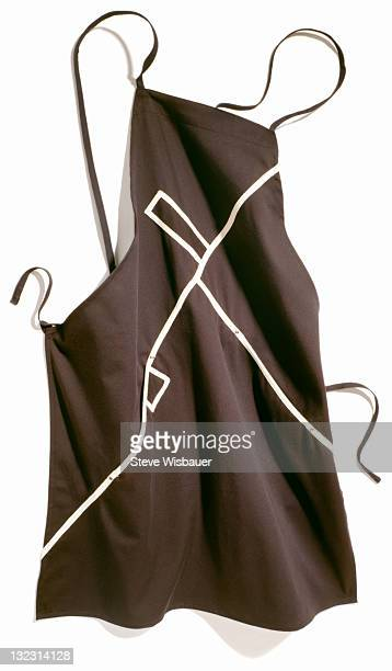 A modern black kitchen apron with white stipes