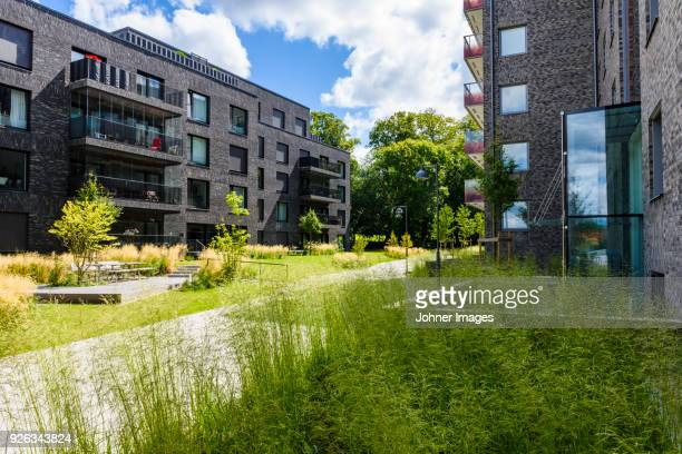 modern blocks of flats - flat stock pictures, royalty-free photos & images