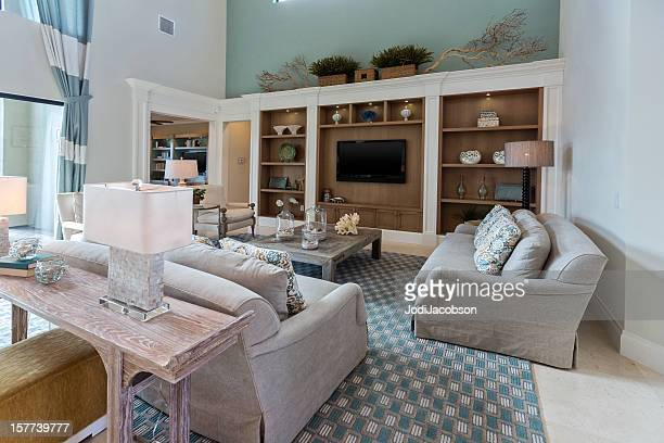 modern blue colored living room - entertainment center stock pictures, royalty-free photos & images