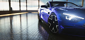 Modern blue coupe sports car in showroom