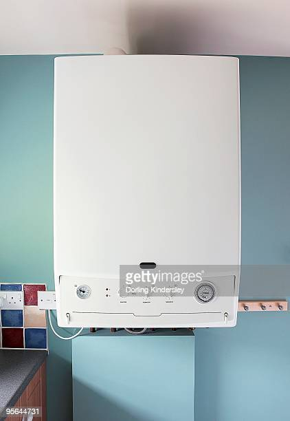 Modern boiler on blue wall in domestic kitchen