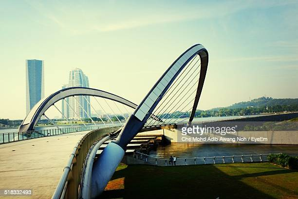 modern bridge against sky - putrajaya stock photos and pictures