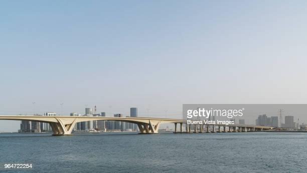 Modern bridge and futuristic skyscrapers