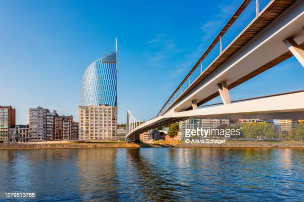 modern bridge crossing meuse river in liège belgium - liege stock pictures, royalty-free photos & images