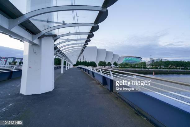 modern bridge during daytime, glasgow, england, uk - image stock pictures, royalty-free photos & images