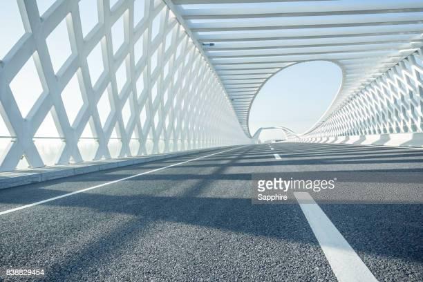 modern bridge in the sunrise, beijing - städtischer verkehrsweg stock-fotos und bilder