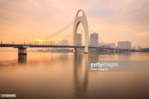 Modern bridge in Zhujiang River and modern building of financial district in guangzhou city, china
