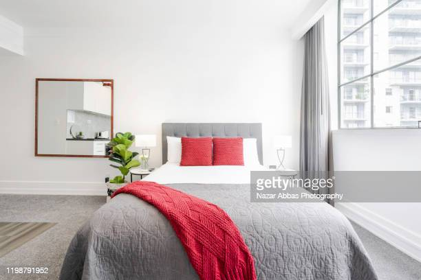 modern bright bedroom. - nazar abbas photography stock pictures, royalty-free photos & images