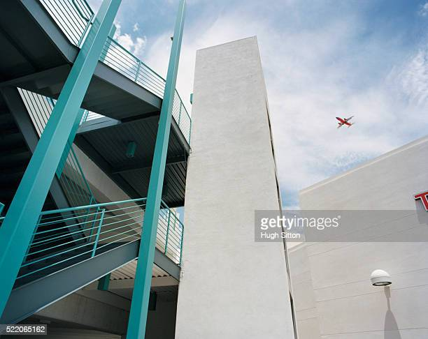 modern building with airplane flying over in background, las vegas, nevada, usa - hugh sitton stock pictures, royalty-free photos & images