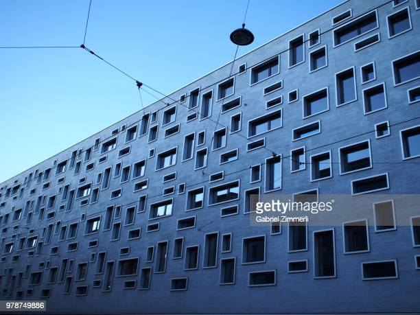 modern building with asymmetrical windows, basel, switzerland - basel switzerland stock pictures, royalty-free photos & images