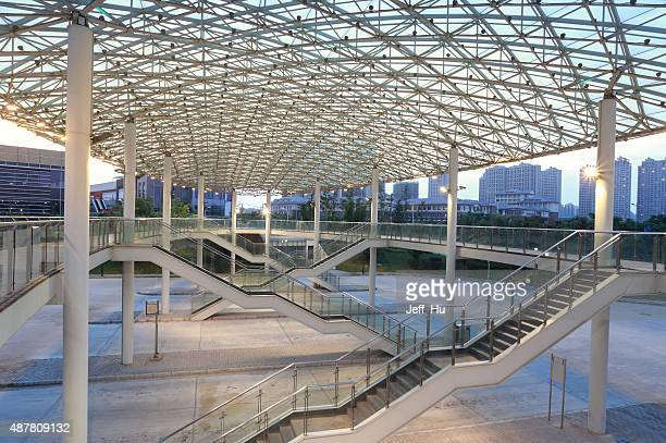 Modern building with curving roof and glass steel column