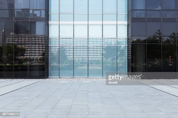 modern building with glass wall in midtown of modern city