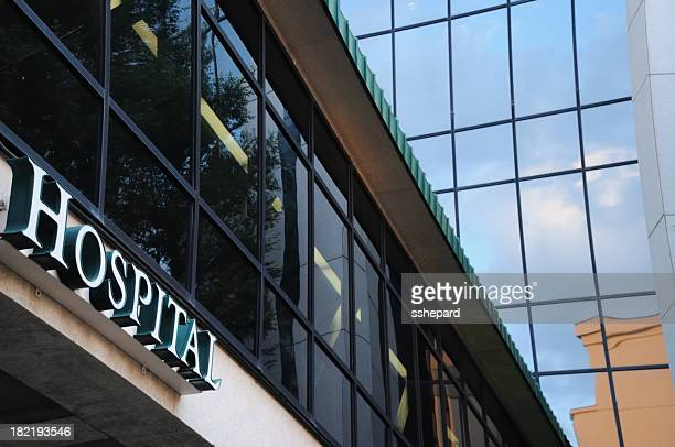 modern building with hospital sign - medical building stock pictures, royalty-free photos & images