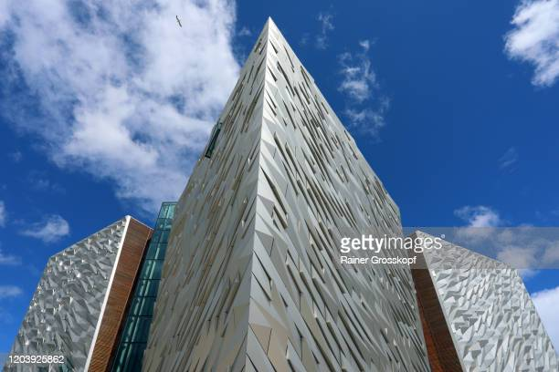 modern building with metallic facades against blue sky with some clouds - rainer grosskopf stock pictures, royalty-free photos & images