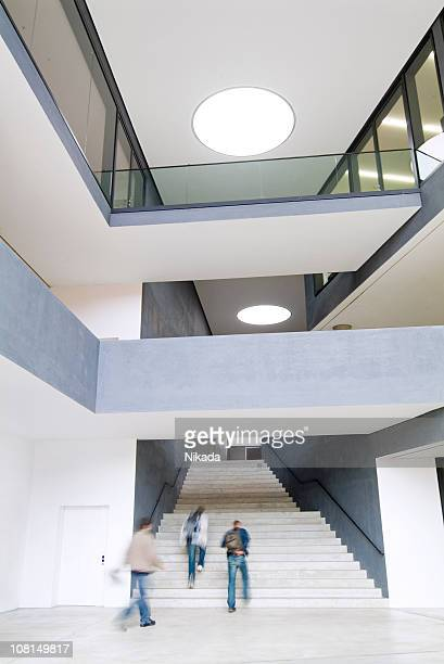 Modern Building with People Walking Up Stairs
