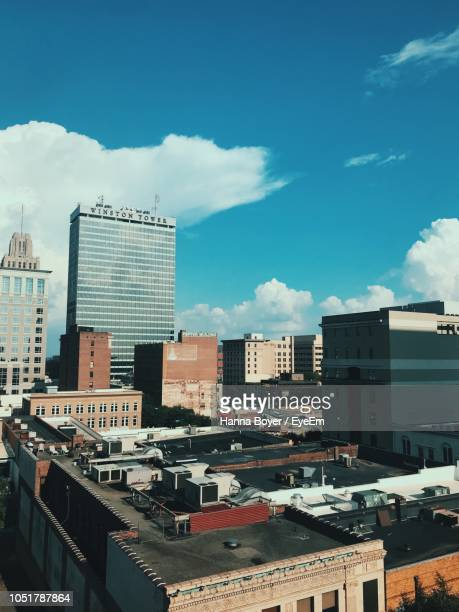 modern buildings against blue sky - winston salem stock pictures, royalty-free photos & images