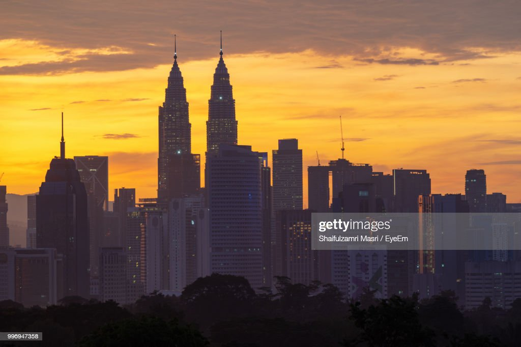 Modern Buildings Against Sky During Sunset : Stock Photo