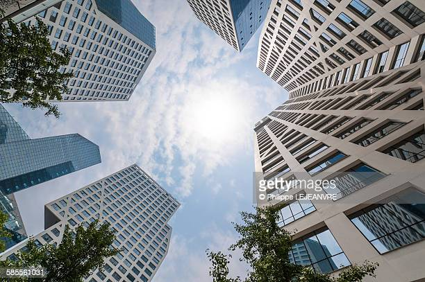 modern buildings against sun - real estate office stock photos and pictures