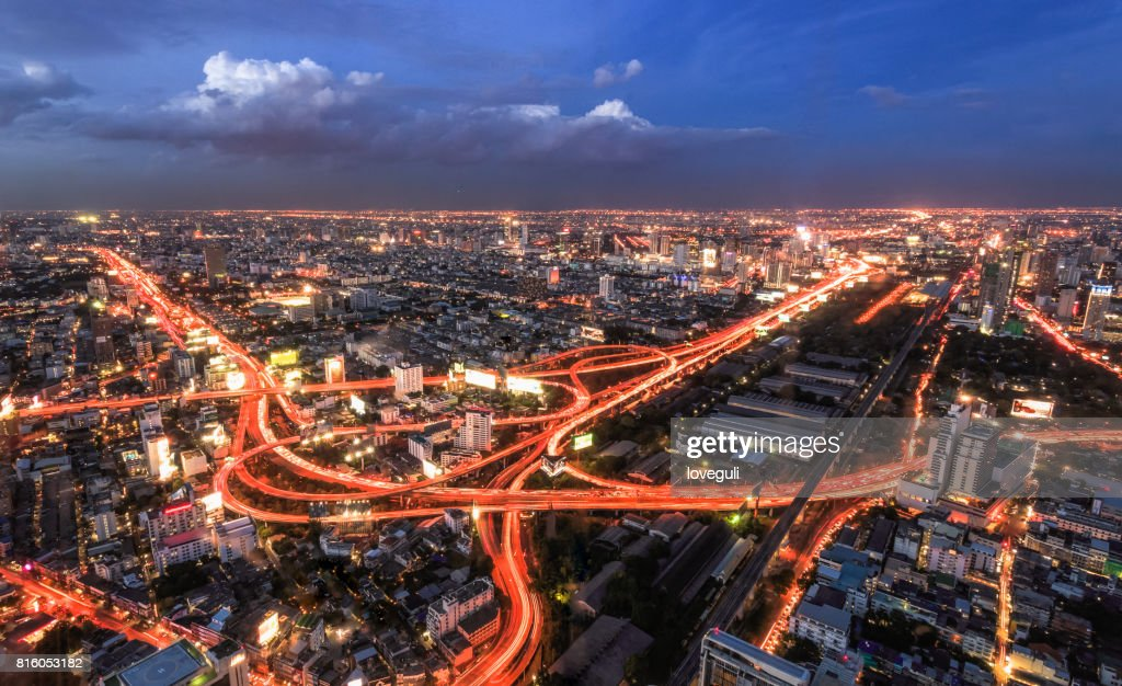 modern buildings and road in modern city at night : Stock Photo