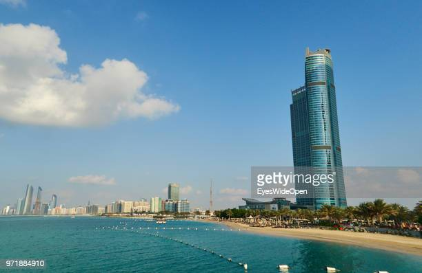 Modern buildings and skyscrapers palm trees and beaches at Saadiyat Island on November 27 2015 in Abu Dhabi Emirate Abu Dhabi