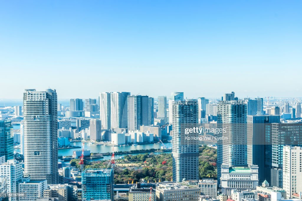 Modern Buildings In City Against Clear Blue Sky : ストックフォト
