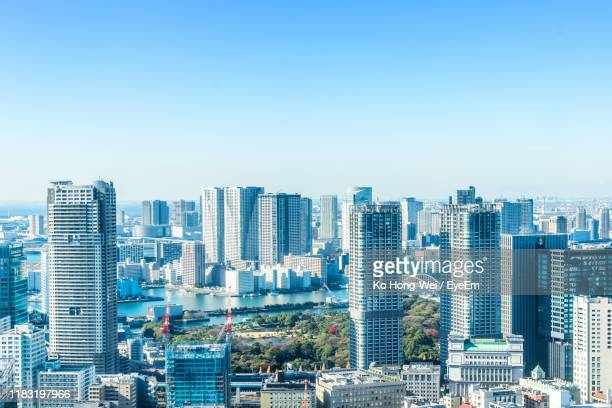 modern buildings in city against clear blue sky - town stock pictures, royalty-free photos & images