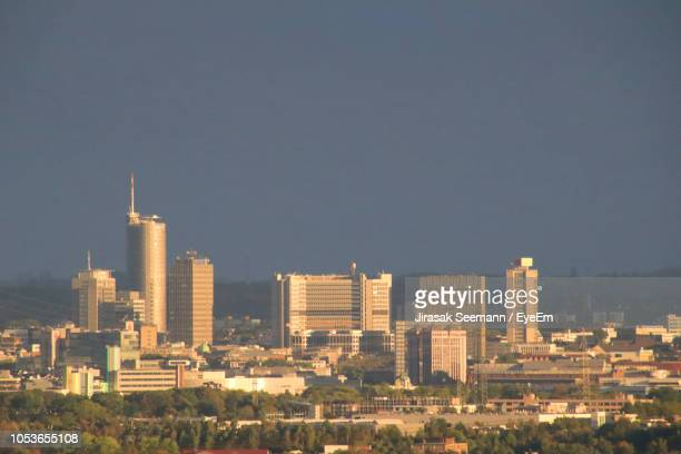 modern buildings in city against clear sky - essen germany stock pictures, royalty-free photos & images